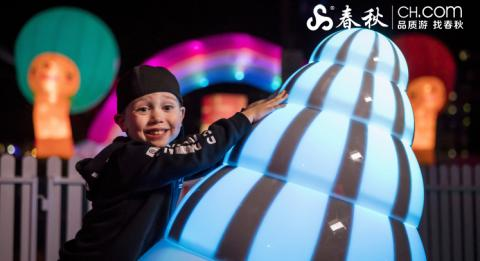 Young boy enjoying an interaction with the Wobbelees light installation in First Fleet Park, The Rocks during Vivid Sydney 2018